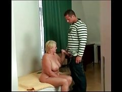 Horny granny jerks off a young cock!